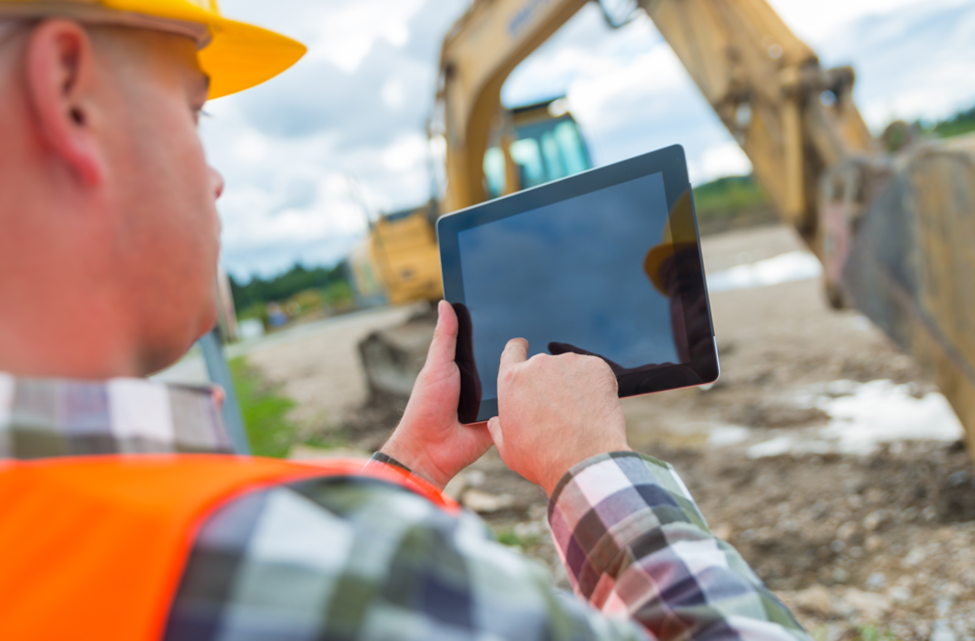 Construction workers with a tablet