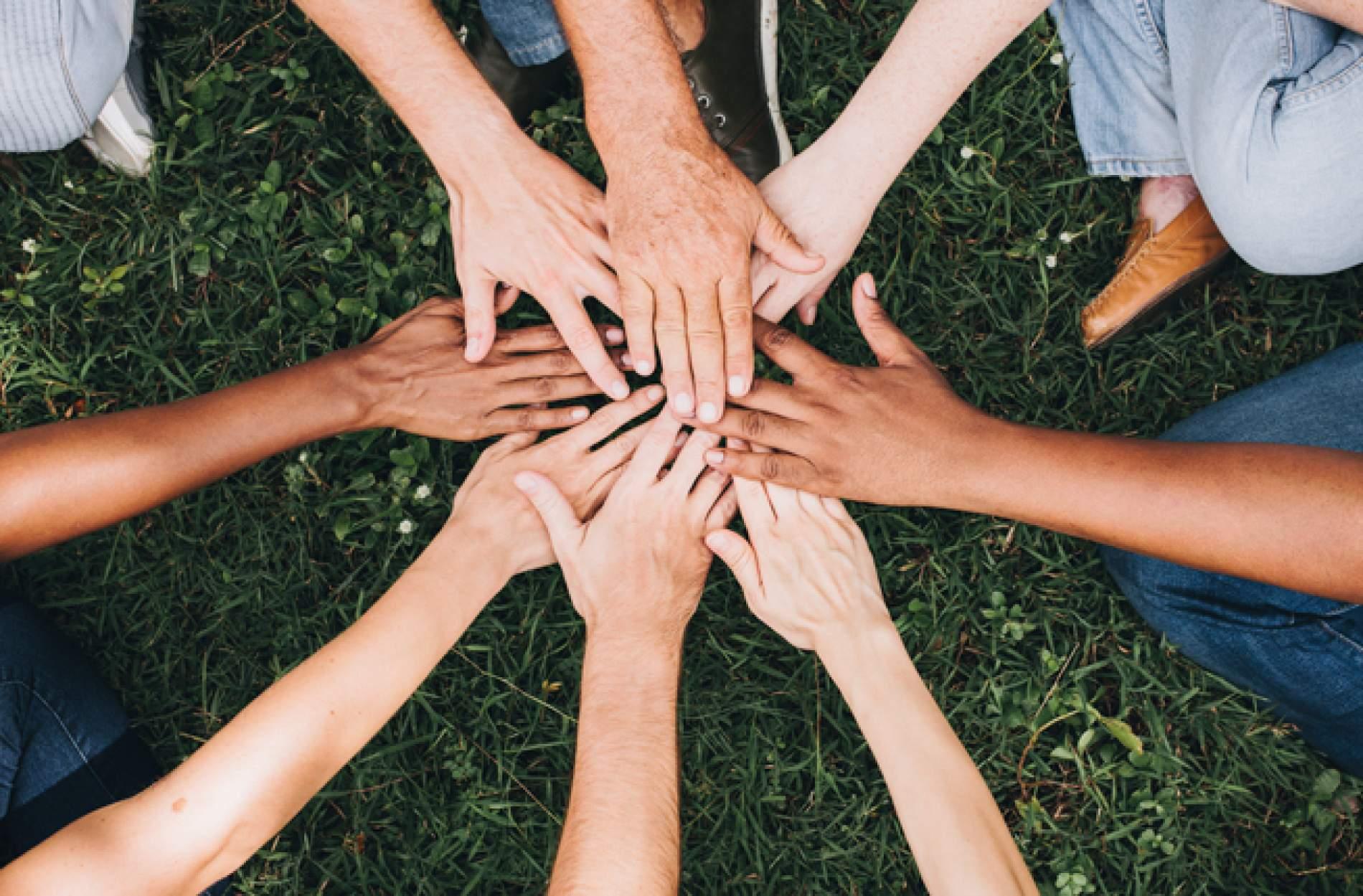 diverse hands together