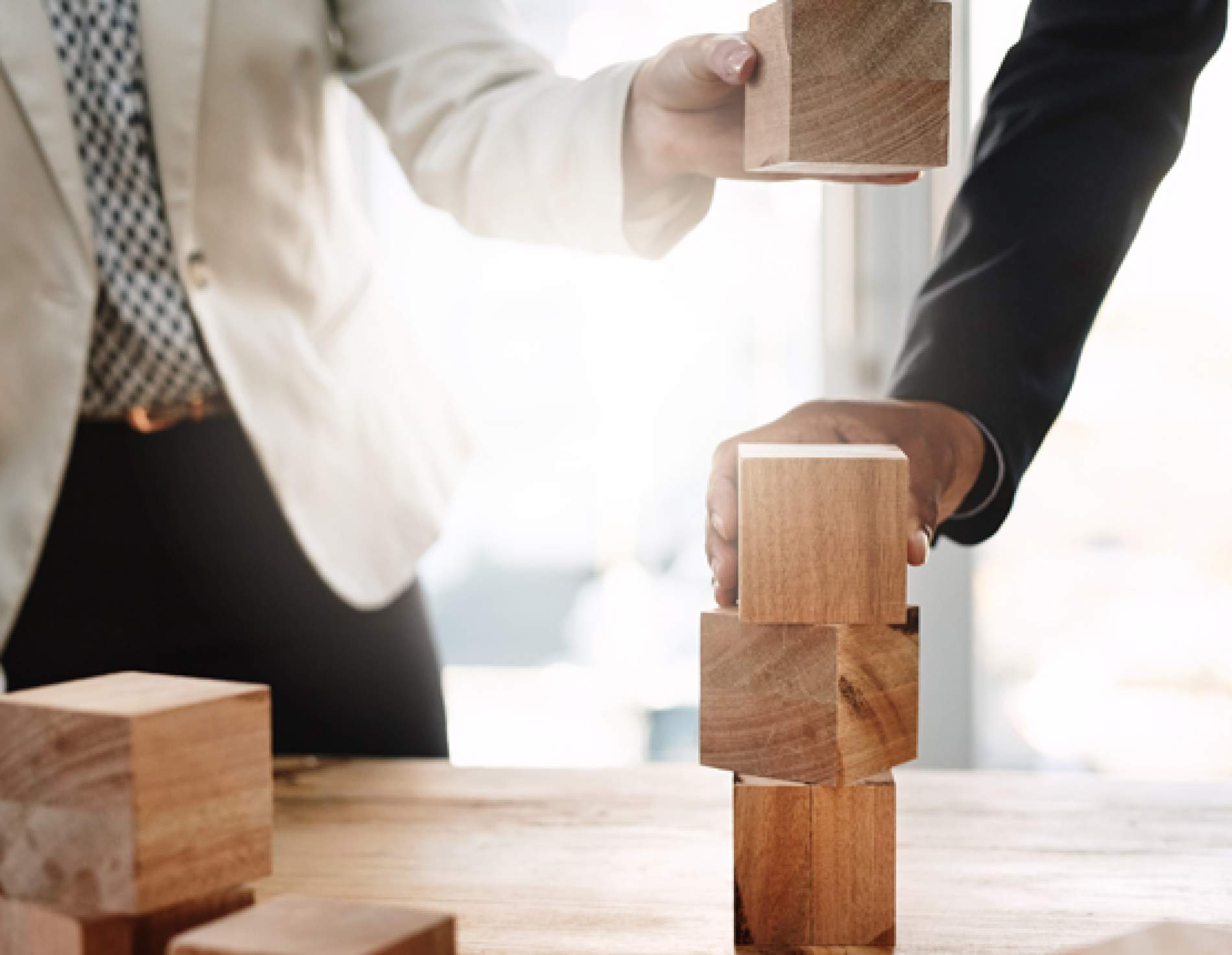 Business professionals with building blocks